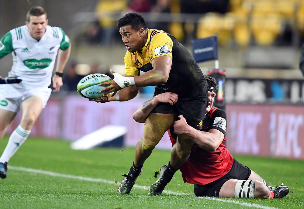 """Hurricanes Julian Savea tackled by Crusaders Scott Barrett in Super Rugby match at Westpac Stadium, Wellington, New Zealand, Saturday, July 15, 2017. Credit:SNPA / Ross Setford  **NO ARCHIVING"""""""