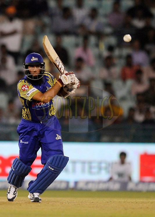 Hashim Amla of Cape Cobras bats during match 3 of the Oppo Champions League Twenty20 between the Cape Cobras and the Northern Knights held at the Chhattisgarh International Cricket Stadium, Raipur, India on the 19th September 2014<br /> <br /> Photo by:  Pal Pillai / Sportzpics/ CLT20<br /> <br /> <br /> Image use is subject to the terms and conditions as laid out by the BCCI/ CLT20.  The terms and conditions can be downloaded here:<br /> <br /> http://sportzpics.photoshelter.com/gallery/CLT20-Image-Terms-and-Conditions-2014/G0000IfNJn535VPU/C0000QhhKadWcjYs