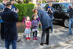 © Licensed to London News Pictures . 30/04/2018. Manchester , UK. British Prime Minister THERESA MAY stops briefly to chat with local residents after visiting Brooklands Primary School in Sale . May is facing questions over her role in the scandal of the way Windrush migrants have been treated and after the resignation of Home Secretary, Amber Rudd, late last night (29 April 2018) . Photo credit : Joel Goodman/LNP