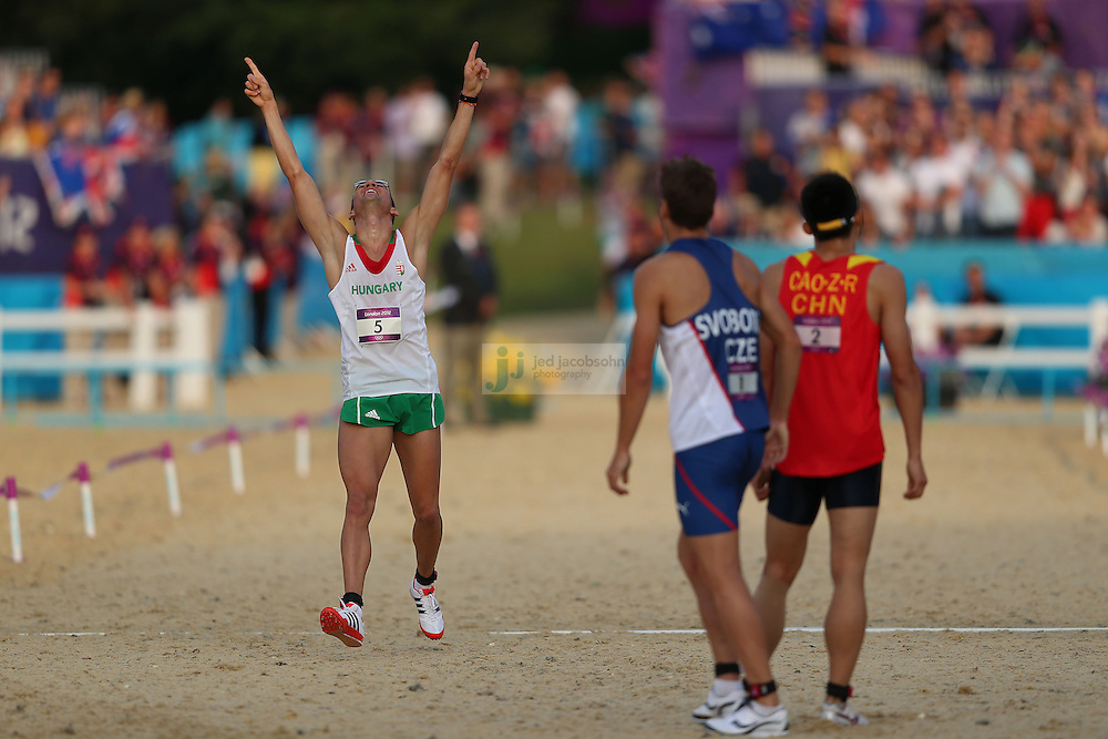 Adam Marosi of Hungary celebrates after finishing third in the men's modern pentathlon during day 15 of the London Olympic Games in London, England, United Kingdom on August 11, 2012..(Jed Jacobsohn/for The New York Times)..