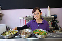 Portrait of a young female employee working in cafe
