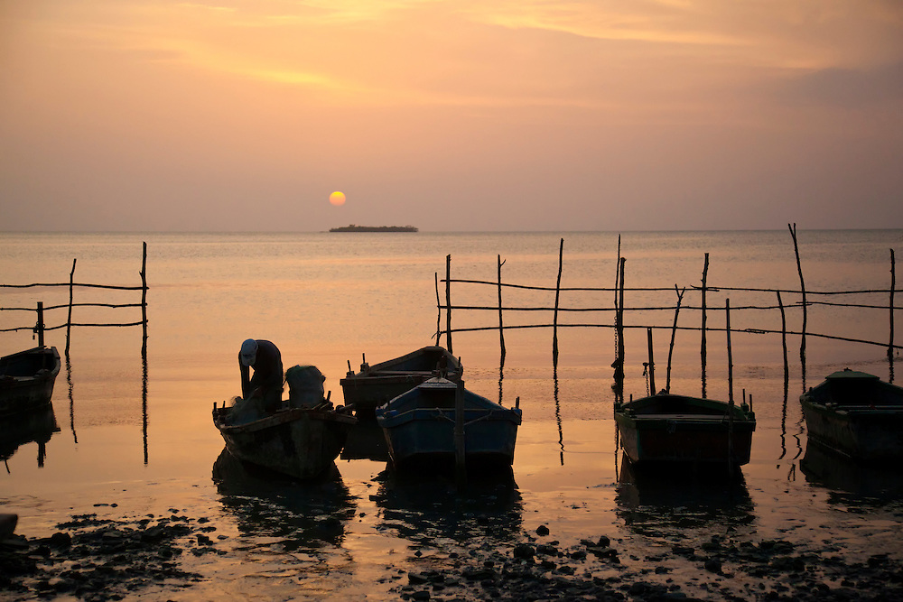Sunset and fishing boats in Niquero, Granma Province, Cuba.