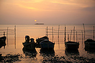Sunset and fishing boats in Niquero, Granma Province, Cuba.