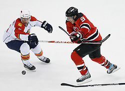 Feb 28, 2009; Newark, NJ, USA; New Jersey Devils left wing Zach Parise (9) skates with the puck during the first period at the Prudential Center.