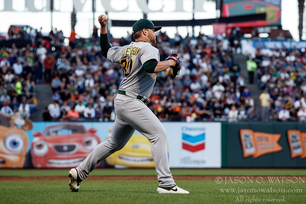 SAN FRANCISCO, CA - AUGUST 13: Brett Anderson #30 of the Oakland Athletics throws to first base against the San Francisco Giants during the second inning at Oracle Park on August 13, 2019 in San Francisco, California. The San Francisco Giants defeated the Oakland Athletics 3-2. (Photo by Jason O. Watson/Getty Images) *** Local Caption *** Brett Anderson