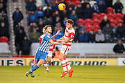Doncaster Rovers midfielder, on loan from Chelsea, Jordan Houghton (16)  wins the header during the EFL Sky Bet League 2 match between Doncaster Rovers and Hartlepool United at the Keepmoat Stadium, Doncaster, England on 19 November 2016. Photo by Simon Davies.