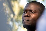 Josephus Weeks, nephew of Ebola patient Thomas Eric Duncan, looks on during a prayer vigil for Duncan at Texas Health Presbyterian Hospital on October 7, 2014, in Dallas. (Cooper Neill for The New York Times)