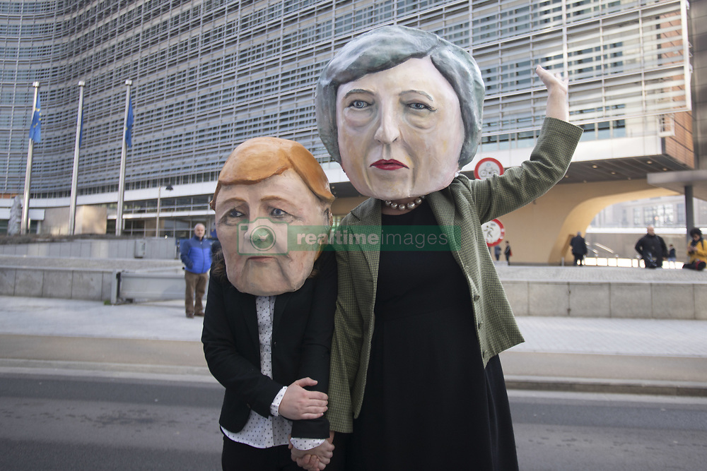 March 21, 2019 - Brussels, Belgium - Anti-Brexit demonstration in front of the Le Berlaymon EU Commission Building before the EU Leader Summit in Brussels, Belgium. Protesters arrived by bus calling for a referendum, with EU and British flags, two of the them were wearing masks of British Prime Minister May and the German Chancellor Merkel.(Credit Image: © Nicolas Economou/NurPhoto via ZUMA Press)