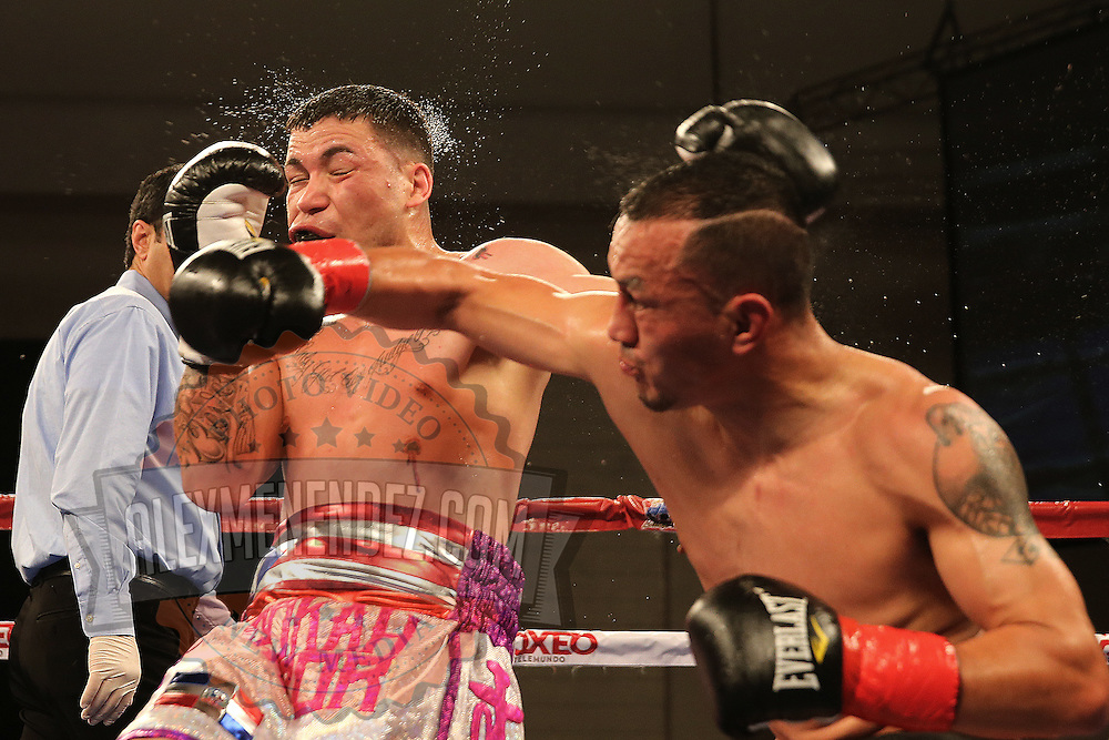 KISSIMMEE, FL - MARCH 06:  Juan Aguirre (R) catches Charles Natal with a right cross during the Telemundo Boxeo boxing match at the Kissimmee Civic Center on March 6, 2015 in Kissimmee, Florida. (Photo by Alex Menendez/Getty Images) *** Local Caption ***  Charles Natal; Juan Aguirre