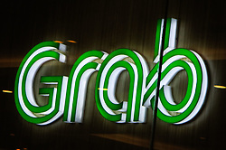 May 27, 2017 - Manila, Philippines - The logo of transport network company Grab is seen inside a mall in Manila, Philippines on Saturday, May 27, 2017. As its accreditation with the Land Transportation Franchising and Regulatory Board (LTFRB) is set to expire by July 2017, Grab Philippines has signed up with an American insurance company to insure GrabCar passengers, as it seeks to address the accountability concerns raised by the LTFRB  over transport network companies (TNC) in the Philippines such as Grab and Uber. (Credit Image: © Richard James Mendoza/NurPhoto via ZUMA Press)