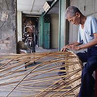 Basket weavers shop, city scene