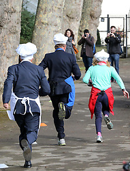 MP's and Lords take part in the Parliamentary Pancake Race held in Westminster,  London, Tuesday, 4th March 2014. Picture by Stephen Lock / i-Images
