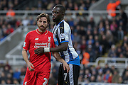Newcastle United midfielder Moussa Sissoko and Liverpool midfielder Joe Allen  during the Barclays Premier League match between Newcastle United and Liverpool at St. James's Park, Newcastle, England on 6 December 2015. Photo by Simon Davies.