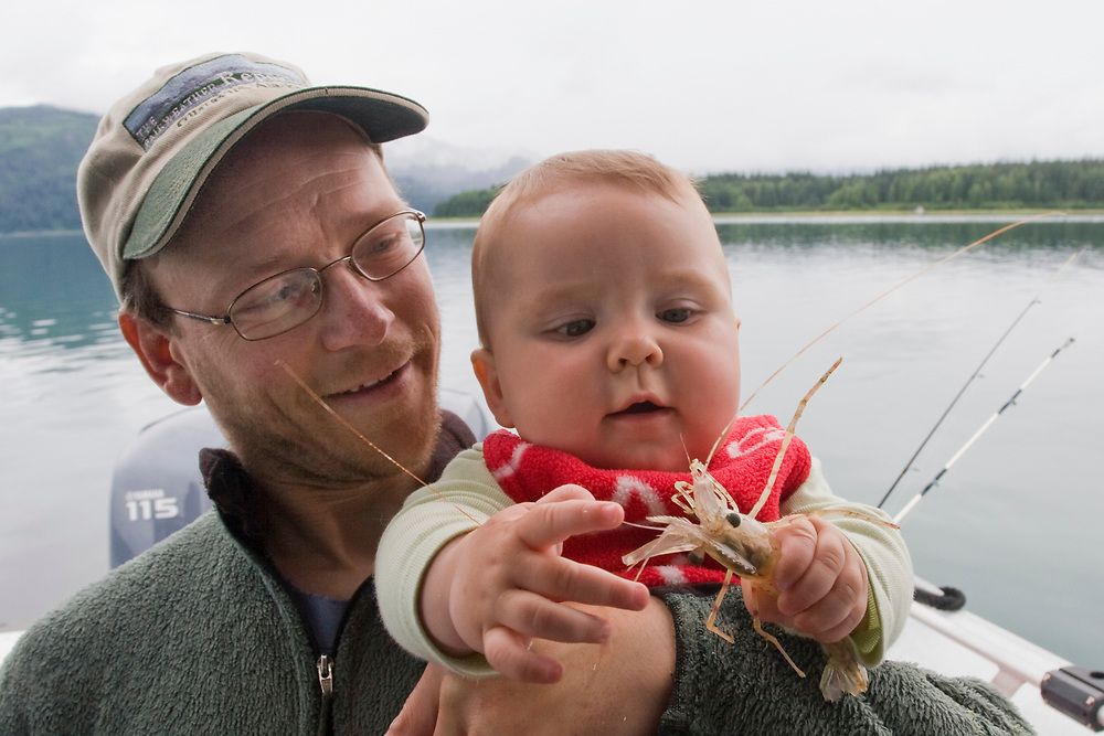 A father and his curious daughter inspect a shrimp caught in Glacier Bay. MR