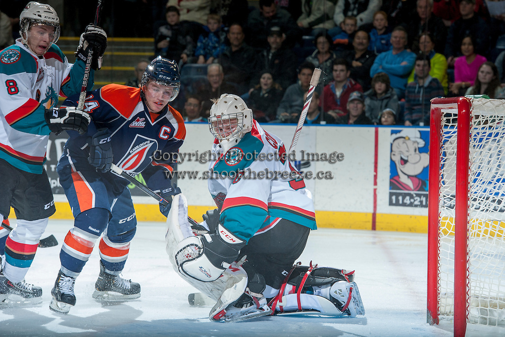 KELOWNA, CANADA - DECEMBER 27: Jordon Cooke #30 of the Kelowna Rockets makes a save on a shot from Matt Needham #14 of the Kamloops Blazers on December 27, 2013 at Prospera Place in Kelowna, British Columbia, Canada.   (Photo by Marissa Baecker/Shoot the Breeze)  ***  Local Caption  ***