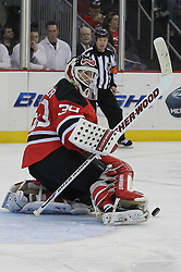 Mar 23; Newark, NJ, USA; New Jersey Devils goalie Martin Brodeur (30) makes a save during the third period at the Prudential Center. The Maple Leafs defeated the Devils 4-3 in an overtime shootout.