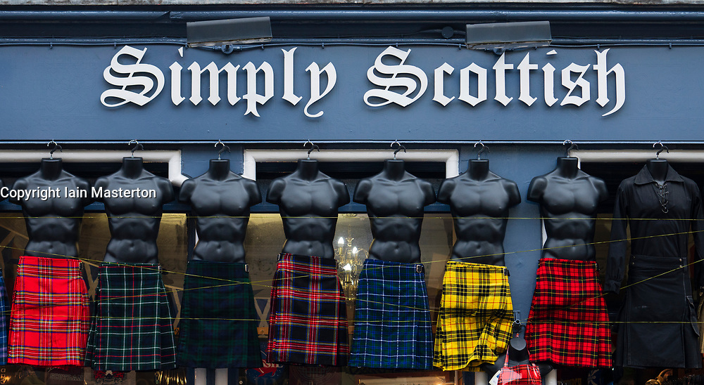 Row of male mannequins wearing kilts outside tourist gift shop on the Royal Mile in Edinburgh, Scotland, UK.