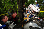 Bill Dragoo and Kevin ? help Briene Thompson (in helmet) push an R1200GS over an obstacle at the BMW GS Trophy Challenge held in Spartanburg, SC.