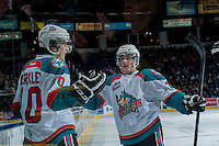 KELOWNA, CANADA -FEBRUARY 19: Nick Merkley #10 and Riley Stadel #3 of the Kelowna Rockets celebrate a goal against the Tri City Americans in the first period; on February 19, 2014 at Prospera Place in Kelowna, British Columbia, Canada.   (Photo by Marissa Baecker/Getty Images)  *** Local Caption *** Nick Merkley; Riley Stadel;