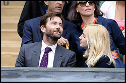 Image ©Licensed to i-Images Picture Agency. 28/06/2014, Wimbledon, London, United Kingdom. David Tennant  and his wife Georgia Moffett watching the tennis on centre court on  Day 6 of the Wimbledon Tennis Championship. Picture by Andrew Parsons / i-Images