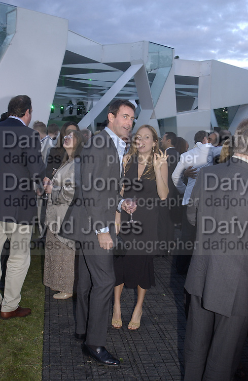 Emily Oppenheimer and tim Jeffries. Serpentine Gallery Summer party in a glass and steel pavilion designed by Toyo Ito and Arup. . tuesday 9 July 2002. © Copyright Photograph by Dafydd Jones 66 Stockwell Park Rd. London SW9 0DA Tel 020 7733 0108 www.dafjones.com