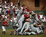 06/09/02 Al Diaz/Herald Staff Photo--Columbia, S.C.--Game three for The University of Miami against the University of South Carolina during the 2002 NCAA Baseball Super Regional at Sarge Frye Field in Columbia, S.C. on Sunday. USC celebrates on the mound as their ball boy Evan Robb, 5, celbrates with them, defeating UM 6-4.