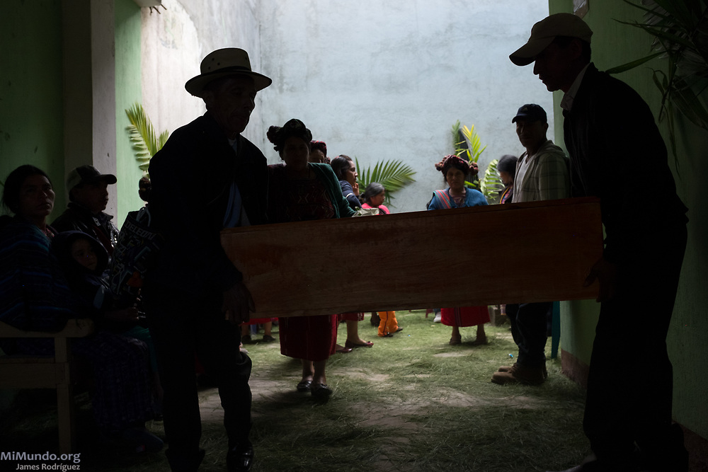Ixil Mayan residents of Nebaj carry the coffin of one of 36 war victims as these are returned to their surviving family members for a proper burial. Most of the victims, exhumed from mass graves in Xe'xuxcap, near Acul, starved in the mountainside while fleeing State-led repression in 1982. Most of the remains, exhumed by members of the Forensic Anthropology Foundation of Guatemala (FAFG) in 2013, were identified using DNA analysis and buried 35 years after their death. Nebaj, Quiché, Guatemala. February 2, 2017.
