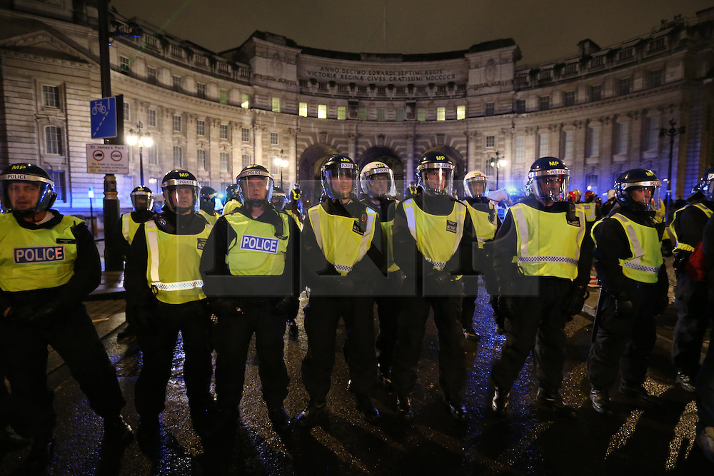 © Licensed to London News Pictures. 05/11/2015. London, UK.  Police stand near Admiralty Arch during the anti-capitalist Million Mask march.  Photo credit: Peter Macdiarmid/LNP