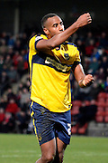 Tyrone Barnett celebrates scoring the equaliser during the Sky Bet League 2 match between Cheltenham Town and Oxford United at Whaddon Road, Cheltenham, England on 29 November 2014.