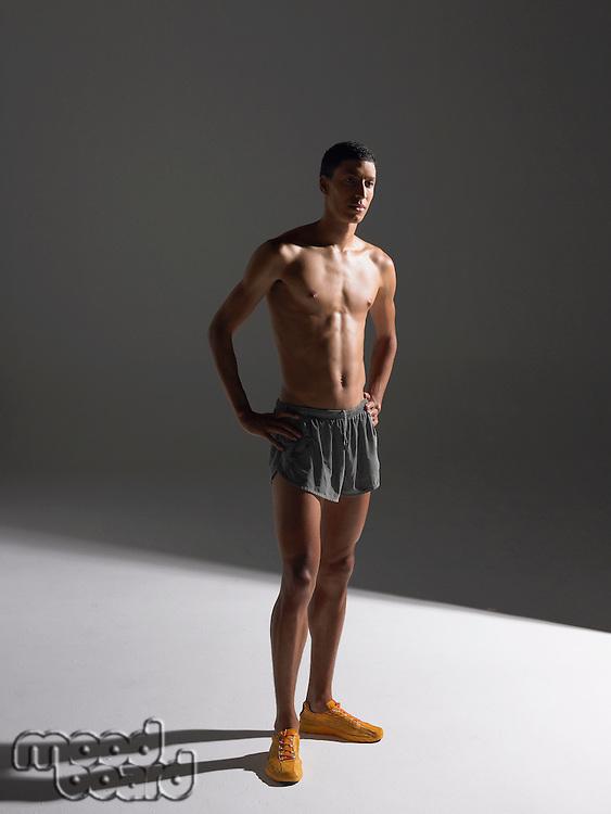 Shirtless athlete standing