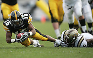 17 NOVEMBER 2007: Iowa wide receiver Derrell Johnson-Koulianos (15) dives for extra yards while being tackled by Western Michigan cornerback Londen Fryar (6) in Western Michigan's 28-19 win over Iowa at Kinnick Stadium in Iowa City, Iowa on November 17, 2007. The play was called back as Johnson-Koulianos was called out of bounds on the catch.