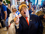 "05 NOVEMBER 2017 - BANGKOK, THAILAND: A ""Donald Trump"" cosplayer promises to ""Make America Great Again"" while a fellow cosplayer holds an iPhone displaying a photo of Putin during a cosplay event at Paragon, an upscale shopping mall in the center of Bangkok.     PHOTO BY JACK KURTZ"