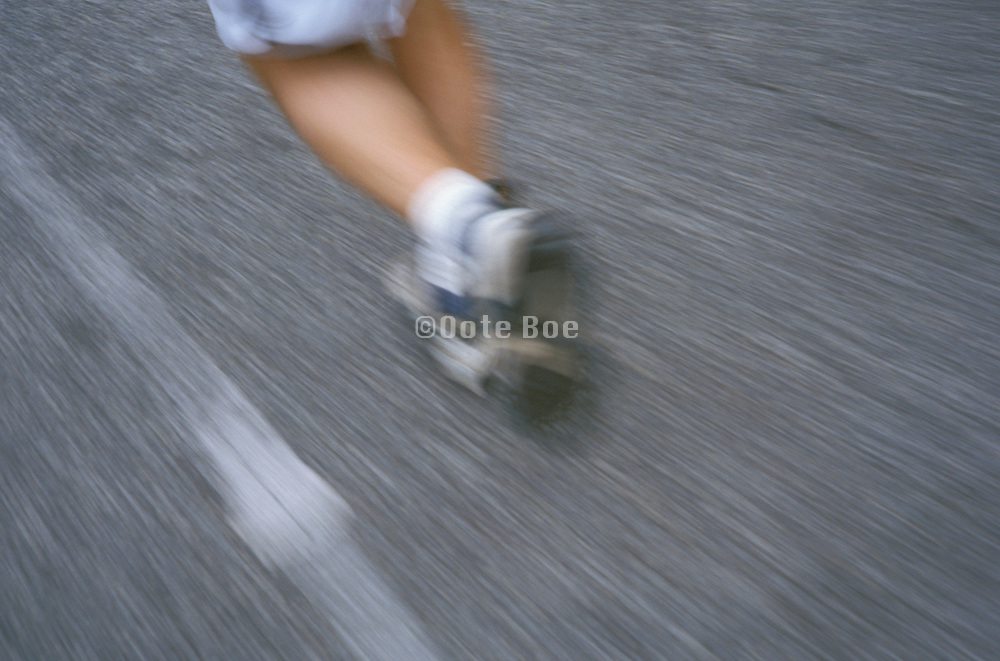 view from knees down of person jogging on the street