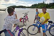 Pattaya Beach. Kid with bike and Osama Bin Laden t-shirt.