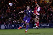 Tyler Walker (17) gets a header in front of Liam Ridehalgh (3)during the EFL Sky Bet League 1 match between Lincoln City and Tranmere Rovers at Sincil Bank, Lincoln, United Kingdom on 14 December 2019.