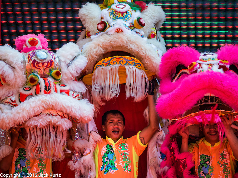 """08 FEBRUARY 2016 - BANGKOK, THAILAND:  Lion dancers perform in Bangkok's Chinatown district during the celebration of the Lunar New Year. Chinese New Year is also called Lunar New Year or Tet (in Vietnamese communities). This year is the """"Year of the Monkey."""" Thailand has the largest overseas Chinese population in the world; about 14 percent of Thais are of Chinese ancestry and some Chinese holidays, especially Chinese New Year, are widely celebrated in Thailand.      PHOTO BY JACK KURTZ"""