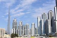 High rise skyscraper apartment blocks and Burj Khalifa tower.