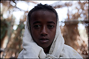 """Tesfaoun, 6 years old, is being married with a girl 1 year younger. In some cultures, arranged marriage is a tradition handed down through many generations. Parents who take their son or daughter's marriage into their own hands have themselves been married by the same process. Child marriages are typically made for economic or political reasons. North West of Ethiopia, on monday, Febrary 16 2009.....In a tangled mingling of tradition and culture, in the normal place of living, in a laid-back attitude. The background of Ethiopia's """"child brides"""", a country which has the distinction of having highest percentage in the practice of early marriages despite having a law that establishes 18 years as minimum age to get married. Celebrations that last days, their minds clouded by girls cups of tella and the unknown for the future. White bridal veil frame their faces expressive of small defenseless creatures, who at the age ranging from three to twelve years shall be given to young brides men adults already...To protect the identities of the recorded subjects names and specific places are fictional."""
