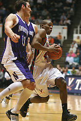 VIrginia point guard Sean Singletary (44) drives the lane against Northwestern.  Singletary's game leading 23 points lead the Cavs to a 72-57 victory at University Hall...The Virginia Cavaliers Men's Basketball team defeated the Northwestern Wildcats 72-57 in the ACC/BigTen Challenge at University Hall in Charlottesville, VA on November 30, 2005..