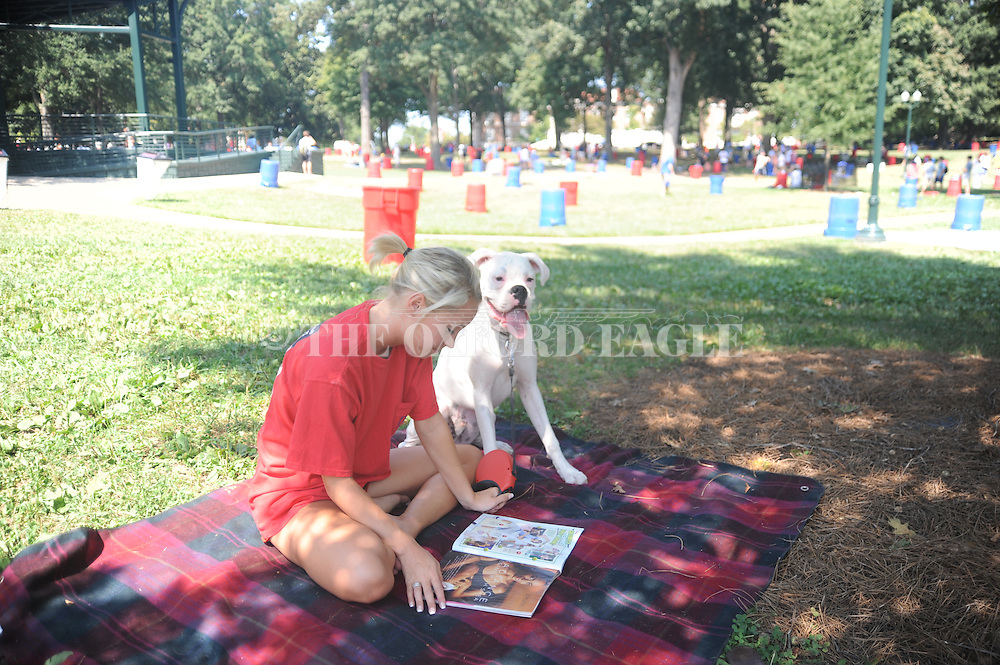 Peyton Carroll, with her dog ZZ, saves a spot in the Grove a day before the Ole Miss Rebels host Southeast Missouri State, in Oxford, Miss. on Friday, September 16, 2013.