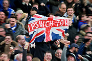 Ipswich Town fans celebrate their goal with a team flag during the EFL Sky Bet Championship match between Norwich City and Ipswich Town at Carrow Road, Norwich, England on 18 February 2018. Picture by Nigel Cole.