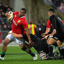 Mako Vunipola is tackled during the 2017 DHL Lions Series 2nd test rugby match between the NZ All Blacks and British & Irish Lions at Westpac Stadium in Wellington, New Zealand on Saturday, 1 July 2017. Photo: Dave Lintott / lintottphoto.co.nz