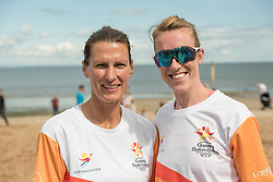 The Commonwealth Games Queen's Baton came to Portobello Beach and it still wasn't the biggest thing happening there. The Big Beach Busk, now in its eighth year was just getting underway when the Baton arrived at the beach volleyball courts by Portobello Baths where a Men's CEV Continental Tour competition was underway. Pictured: Scottish Women's Beach Volleyball Mel Coutts Lynne Beattie<br /> <br /> <br /> &copy; Jon Davey/ EEm