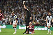 West Bromwich Albion midfielder (on loan from Fulham) Stefan Johansen (6) shown a yellow card, booked  during the EFL Sky Bet Championship play-off second leg match between West Bromwich Albion and Aston Villa at The Hawthorns, West Bromwich, England on 14 May 2019.