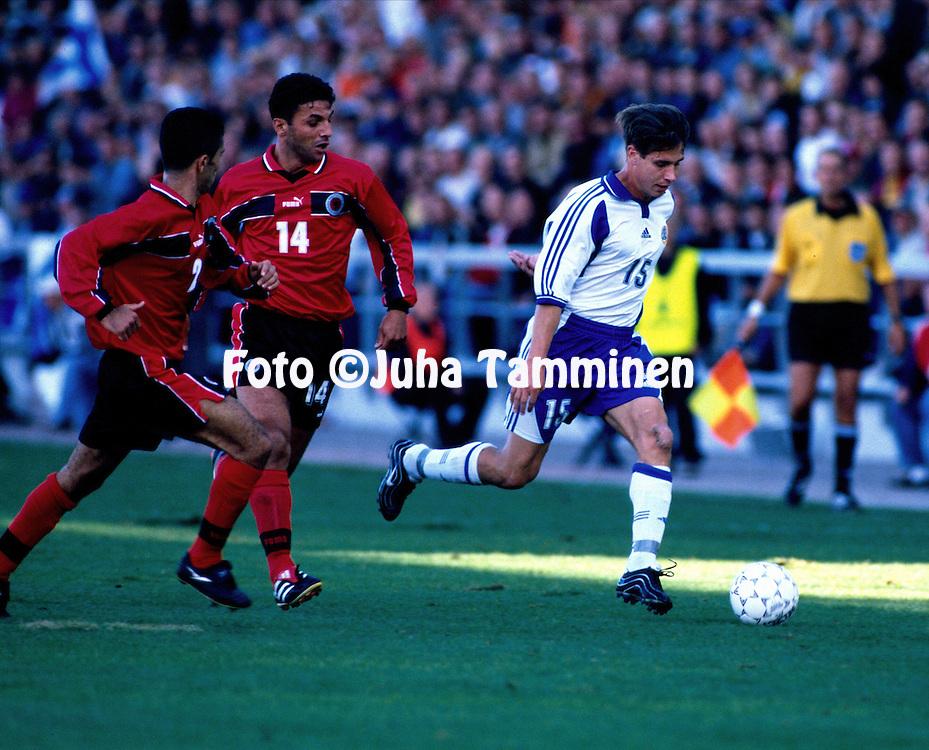 02.09.2000 Finnair Stadium, Helsinki, Finland. FIFA World Cup Qualifying Match, Finland v Albania. Harri Yl?nen (FIN) v Altin Lala (2) & Alban Bushi (ALB)..©JUHA TAMMINEN
