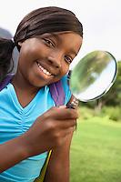 Girl Using Magnifying Glass