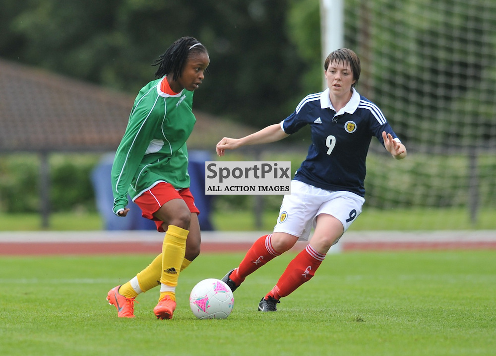 Megan Sneddon keeps an eye on tghe ball during the Cameroon vs Scotland in pre Olympic warm up match. 15th July 2012.