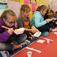 Saltillo Elementary School fourth grader Tabitha Burrage uses chopsticks to eat hibachi chicken and rice during their Japanese culture day at the culmination of their unit on the country and it's culture.