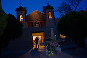 Dusk envelopes El Santuario de Chimayo, Thursday, April17, 2014 as pilgrims begin to arrive on the church steps ahead of Good Friday. El Santuario de Chimayo, was built by the Spanish in 1813. AP Photo/Jeremy Wade Shockley