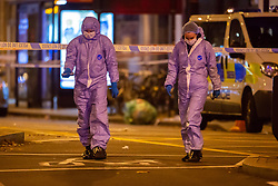 Forensics investigators examine the road outside the station at the scene where a seventeen-year-old , the second teenager in less than 24 hours, was stabbed and died outside Clapham South Underground Station. Clapham South, London, November 02 2018.